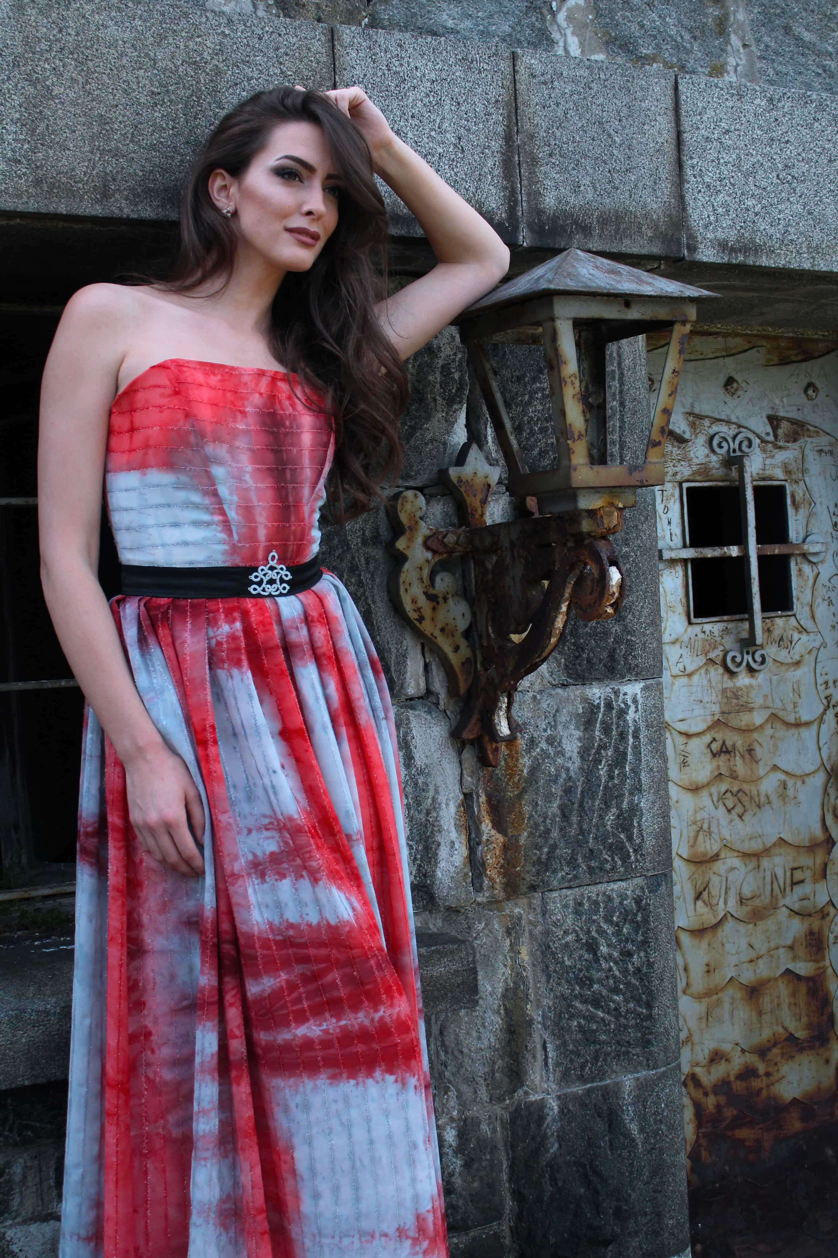 Sarossow couture red and grey dress with black belt and handmade details landscape by Sladjana Starcevic