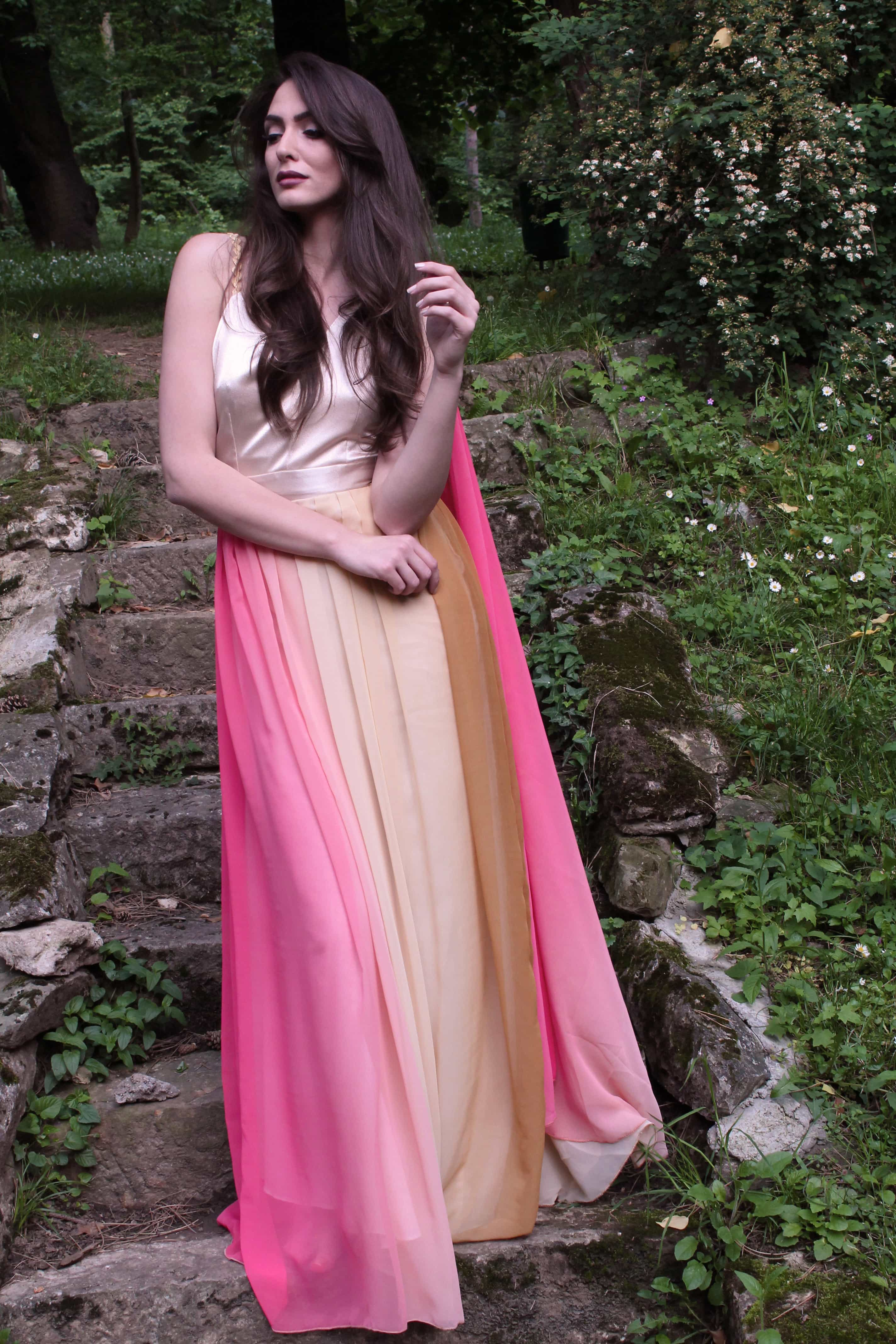 Sarossow couture pink and yellow dress with handmade details standing by Sladjana Starcevic